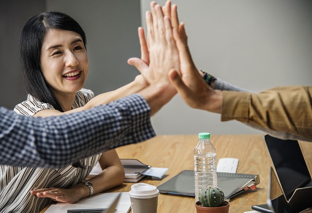 Employees High Five for Success